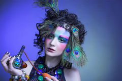Woman in peacock image. Stock Images