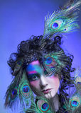 Woman in peacock image. Royalty Free Stock Image
