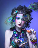 Woman in peacock image. Stock Photography