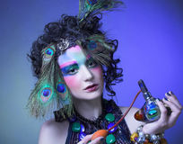 Woman in peacock image. Royalty Free Stock Images