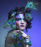 Woman in peacock image. royalty free stock photography