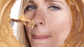 Woman with peanut butter and chocolate Stock Photos