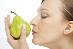 WOMAN WITH PEAR Royalty Free Stock Images