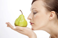 WOMAN WITH PEAR Stock Images