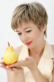 Woman with a pear Royalty Free Stock Image