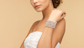 Woman with pearl bracelet Stock Photography