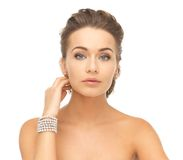 Woman with pearl earrings and bracelet Royalty Free Stock Photos