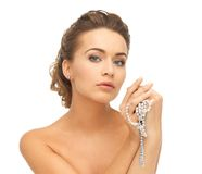Woman with pearl earrings and necklace Royalty Free Stock Photos