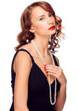 Woman with pearl necklace Stock Images