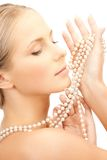 Woman with pearl necklace Stock Photography