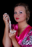 Woman with pearl necklace in hand Royalty Free Stock Image