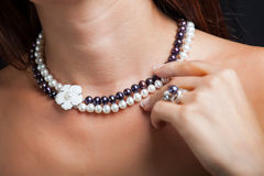 Woman with pearl necklace on her neck Royalty Free Stock Images