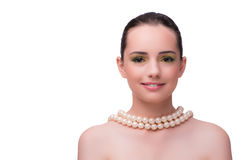 The woman with pearl necklace isolated on white Stock Photography