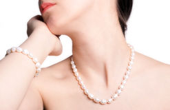 Woman in pearls. Young beautiful woman in pearly necklace and bracelet Royalty Free Stock Photos