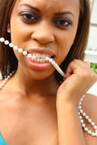 Woman With Pearls In Her Mouth Royalty Free Stock Images