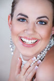 Woman in pearls laughing Stock Photos