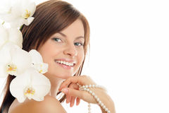 Woman with pearls and orchid Royalty Free Stock Images