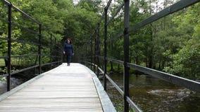 Woman on pedestrian bridge stock video footage