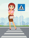 Woman on the pedestrian crossing Royalty Free Stock Photo