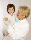Woman pediatrician with girl Stock Photos