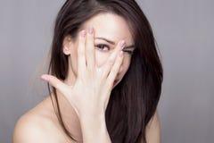 Woman peeking Stock Photography