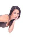 Woman peeking holding her long hair Royalty Free Stock Photography