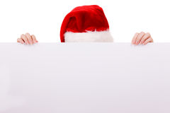 Woman peeking over empty banner board. Christmas Stock Images