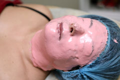 Woman with peel off face mask Stock Photos