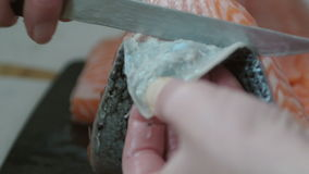 Woman peeling fish stock footage