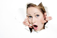 Woman peeping through hole in paper Stock Image