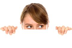 Woman peeping over a blank billboard Stock Photography