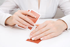 Woman peeping in under playing card Royalty Free Stock Photo