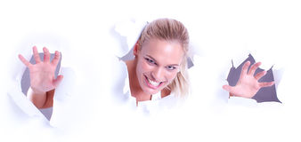 Woman peer through the wallpaper and smiling Stock Photo