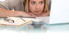 Woman peering at her laptop Stock Photos