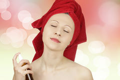 Woman pefuming after bath Stock Photos