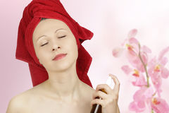 Woman pefuming after bath Stock Photography