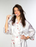 Woman in peignoir with toothbrush Stock Photo