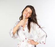 Woman in peignoir with toothbrush Royalty Free Stock Photo
