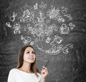 Woman with pen and marriage icons Royalty Free Stock Photography