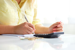 Woman with pen and money Royalty Free Stock Images