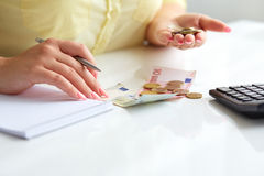 Woman with pen and money Stock Photos