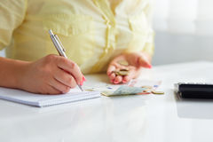 Woman with pen and money Stock Photo