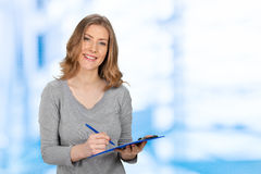 Woman With Pen and Note Pad Stock Photography