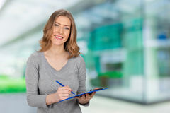 Woman With Pen and Note Pad Royalty Free Stock Photos