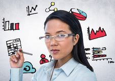 Woman with pen and pink blue yellow business doodles against white wall Royalty Free Stock Image