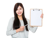 Woman pen point to blank note pad Royalty Free Stock Image