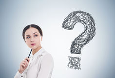 Woman with pen and question mark Stock Photos