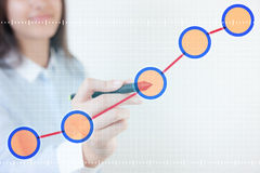 Woman pen touch chart data Stock Images