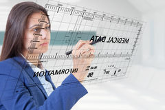 Woman pen touch medical data. Woman pen touching medical data screen royalty free stock image