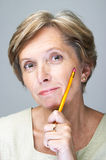 Woman with pencil Stock Photography